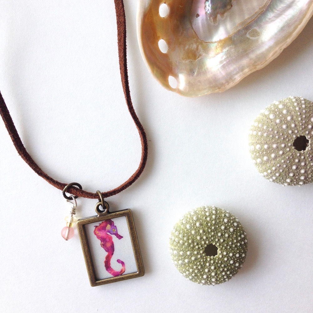 Pink Galaxy Seahorse Aloha Charm necklace...hanging out on my desk.