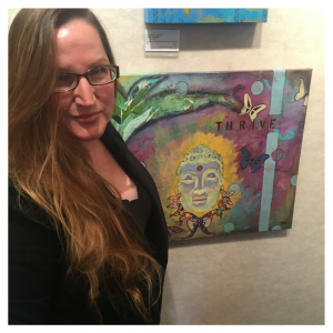 "Artist Mika Harmony stands in front of her ""Abundance"" Buddha painting at the BAA Gallery in Ventura, CA"
