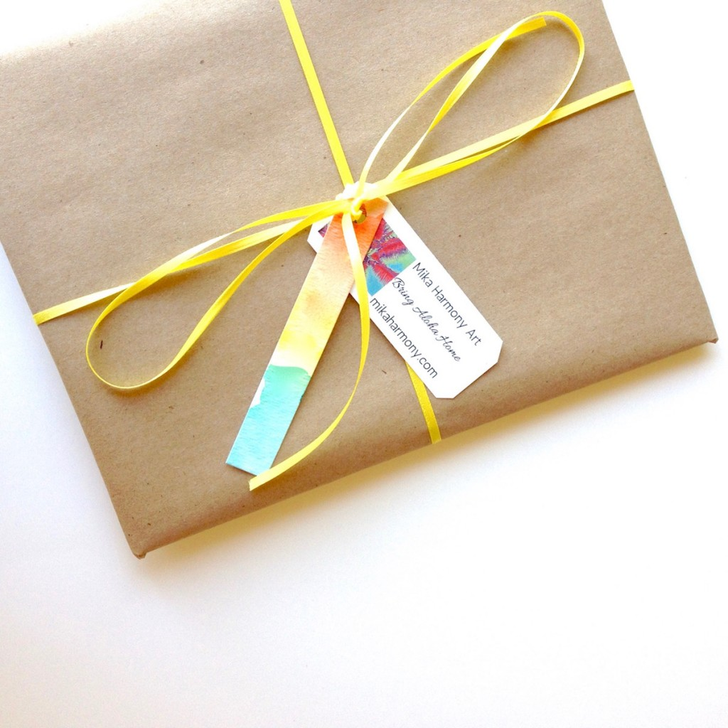 gift wrapped art with hand painted watercolor tag by Mika Harmony Art