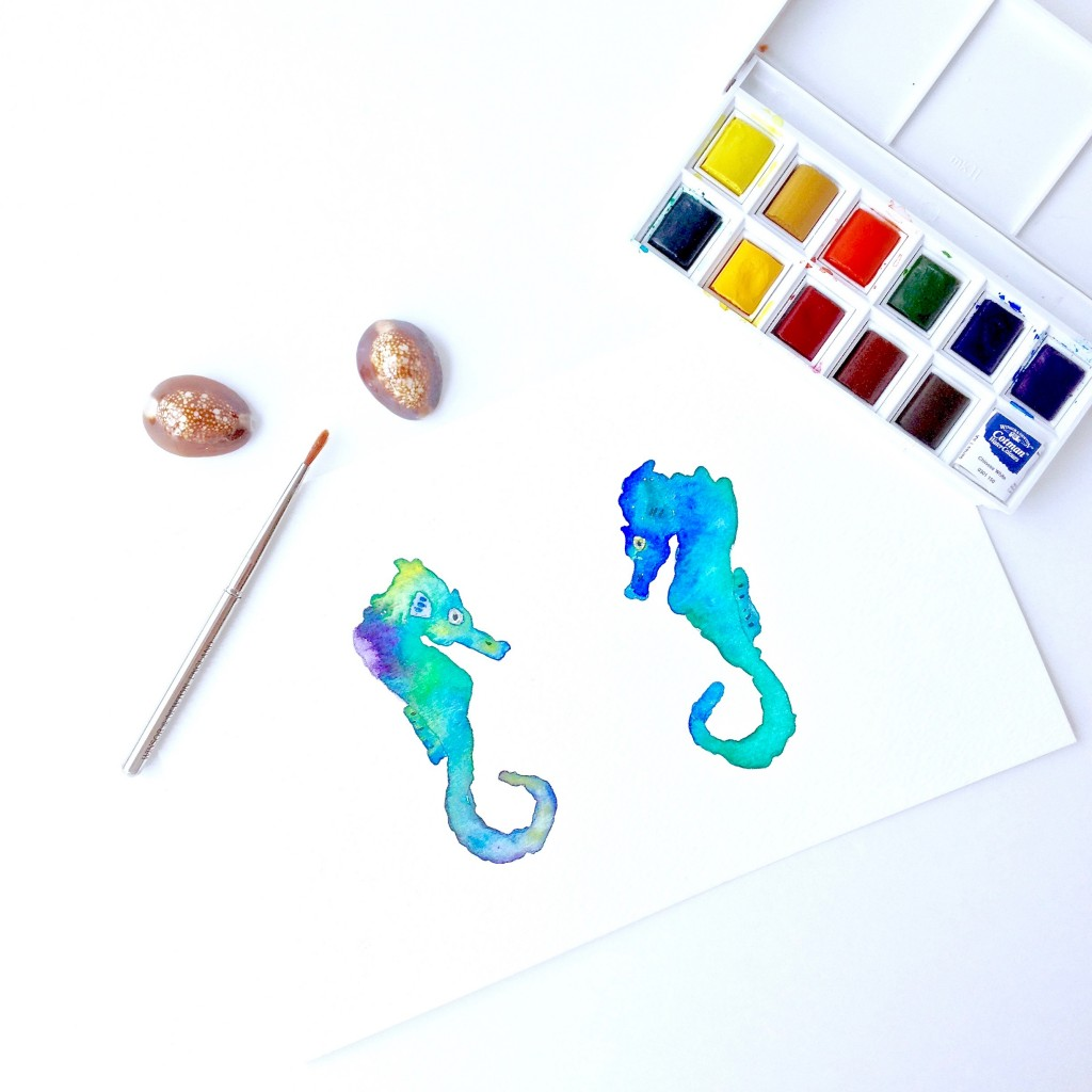 Pair of seahorse painted in cool blues and greens