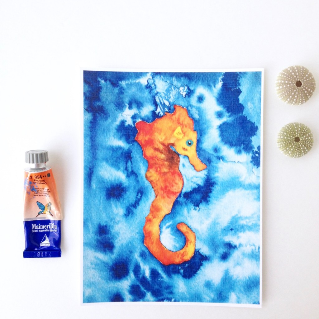 Orange Baby Seahorse on a blue watercolor background by Mika Harmony