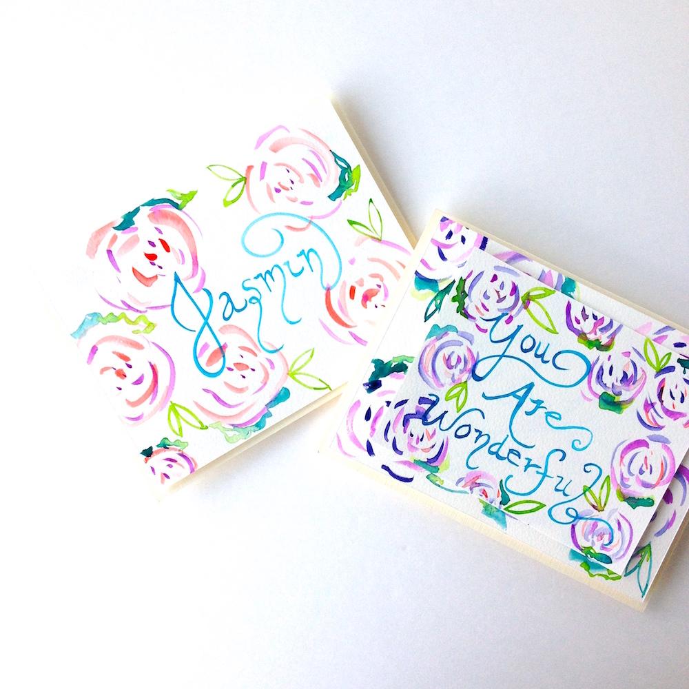 Watercolor roses handpainted cards on Mika Harmony's Art Studio desk